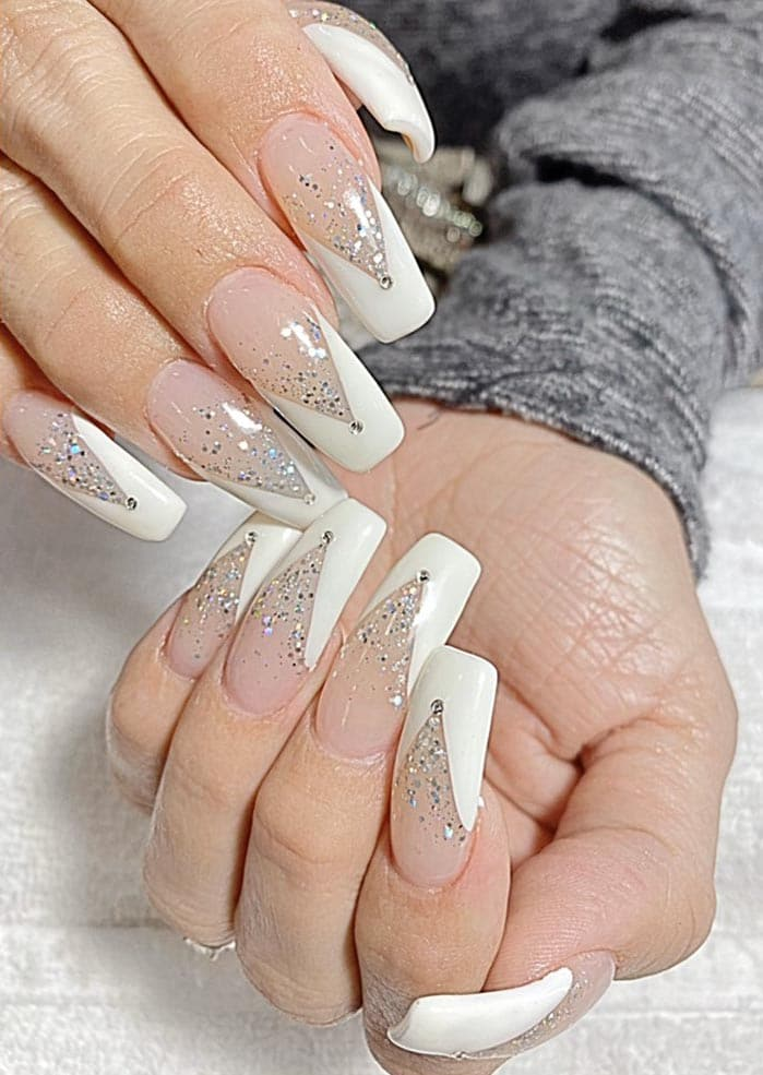 Long nails with V shape French tip
